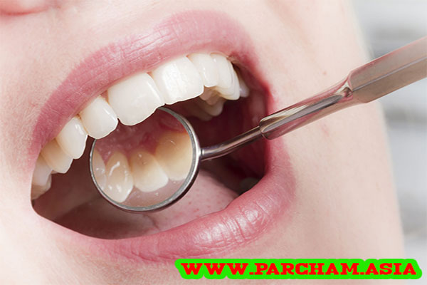 معاینه دندان در موثرترین قرص برای عفونت دندان